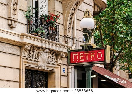 Paris, France - August 11, 2017. Red Metro Entrance Sign In Paris. Old Traditional Signpost For Subw