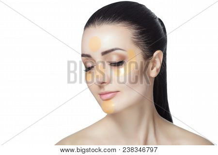 Collagen Gold Patches On The Skin Of The Eyelid, Forehead And Chin On The Face Of A Beautiful Woman.
