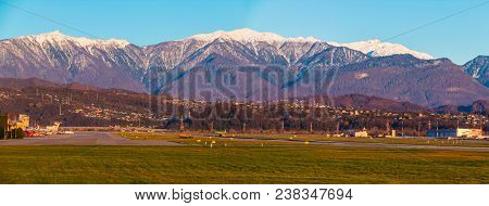 Panoramic View Of The Airdrome Of Sochi International Airport On The Background Of Mountains In Sunn