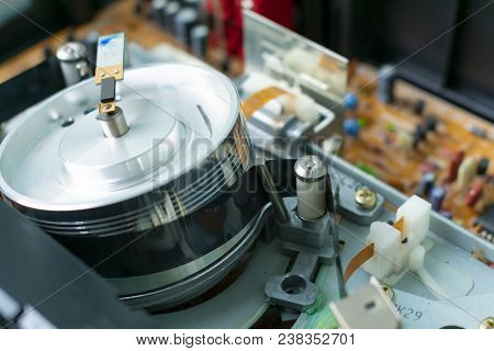 Videocassette Is Put Into The Video Recorder To Watch The Video, Another Video Cassette Is On The Vi