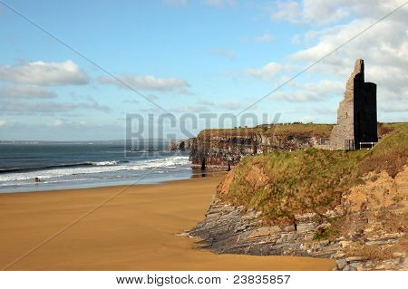 ballybunion castle on the cliffs in the west coast of ireland above a beautiful beach with horses poster