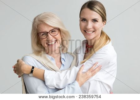 Happy Attractive Senior Older Aged Mother And Young Adult Daughter Smiling Laughing Looking At Camer