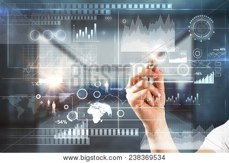 Businessman Hand Pointing At Abstract Digital Business Interface Hologram On Blurry Office Interior