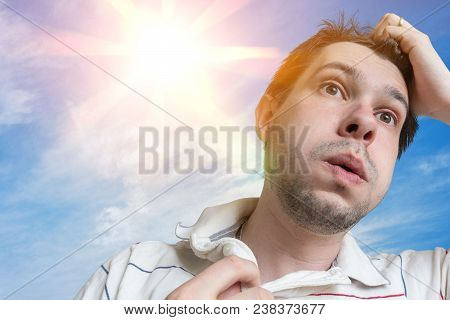 Hot Weather Concept. Young Man Is Sweating. Sun In Background.