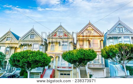 Late Afternoon Sun Light Up A Row Of Colorful Victorian Houses Known As Painted Ladies Across From A