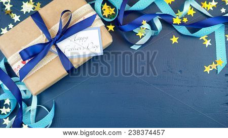 Father's Day Overhead With Decorated Borders On Dark Blue Wood Table.
