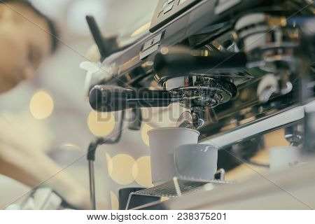 Unrecognizable Barista, Working At Bar. Making Coffee In Coffee Machine. Fresh Espresso. Coffee Cult