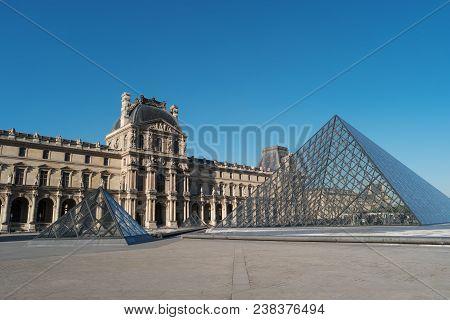 Paris, France, April 27, 2017: Louvre Museum, Building And Pyramid, France, Europe. Louvre Museum Is