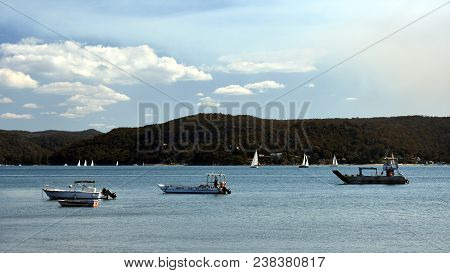 Yachts Sailing On The Water At Pittwater Bay, Sydney Australia. View From Palm Beach.
