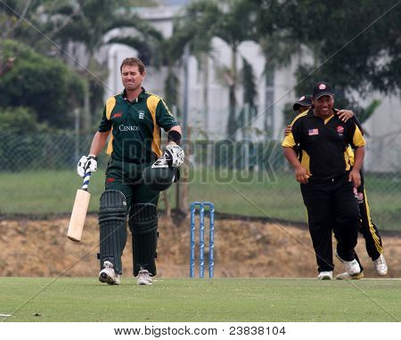 PUCHONG, MALAYSIA - SEPT 24: Guernsey's batsman Adam Martel leaves the field in this Pepsi ICC World Cricket League Div 6 finals vs Malaysia at the Kinrara Oval on Sept 24, 2011 in Puchong, Malaysia.