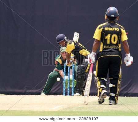 PUCHONG, MALAYSIA - SEPT 24: Malaysia's Mohd Safiq (10) watches Aminuddin bat in this Pepsi ICC World Cricket League Div 6 finals vs Guernsey on Sept 24, 2011 at the Kinrara Oval, Puchong, Malaysia.