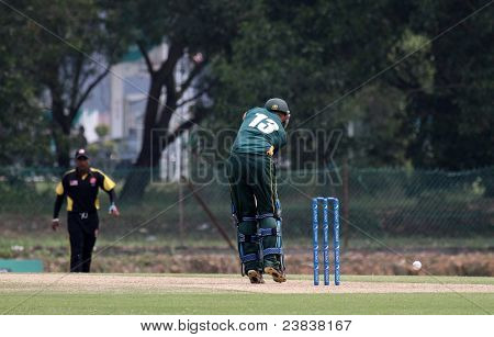PUCHONG, MALAYSIA - SEPT 24: Guernsey's Tim Ravenscroft (13) bats the ball in this Pepsi ICC World Cricket League Div 6 finals vs Malaysia at the Kinrara Oval on Sept 24, 2011 in Puchong, Malaysia.