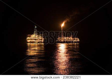Fpso Tanker Vessel Near Oil Rig. Offshore Oil And Gas Industry, Sea Oil Production And Storage. Flar