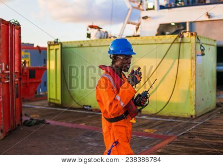 Seaman Ab Or Bosun On Deck Of Offshore Vessel Or Ship , Wearing Ppe Personal Protective Equipment -