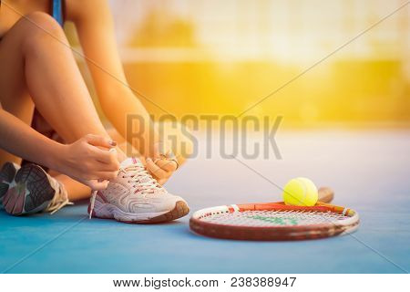 Sport Tennis Player Tying Shoelaces In Court. Sunset Sport Tennis Player Racket. Sport Tennis Player