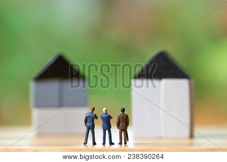 Miniature Businessmen Standing Investment Analysis Housing Or Investment In Movable Property. Using
