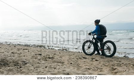 Fat Bike Also Called Fatbike Or Fat-tire Bike In Summer Driving On The Beach. The Guy Is Going Strai