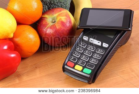 Payment Terminal, Credit Card Reader With Mobile Phone With Nfc Technology And Fruits And Vegetables