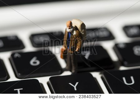 Tiny Man And White Notebook Keyboard. Computer Keyboard Closeup With Focus On Y Button. Internet Bro