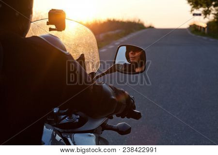 close up portrait of rider on a motorcycle - summer road trip on a motorbike