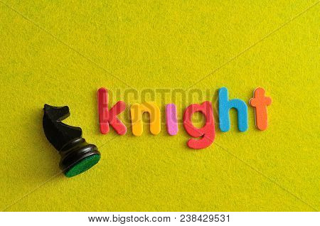 A Knight Chess Piece With The Word Knight On A Yellow Background