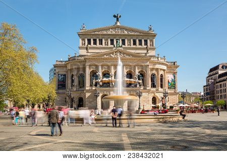 Old Opera House Alte Oper In Frankfurt Main In Springtime With Opernplatz Fountain And Walking Peopl