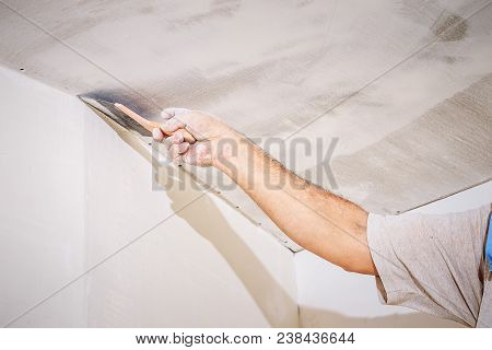 manual worker with wall plastering tools worker putty wall and ceiling poster