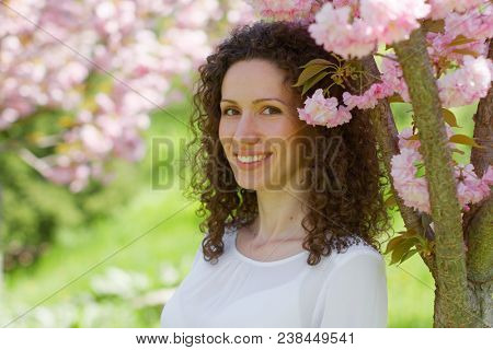 curly hair smiling woman