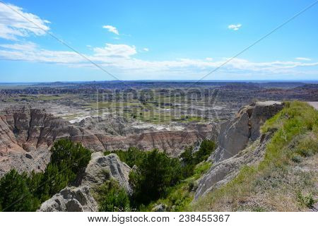 Badlands National Park. The parks 244,000 acres protect an expanse of mixed-grass prairie that support bison, bighorn sheep, prairie dogs, and black-footed ferrets.