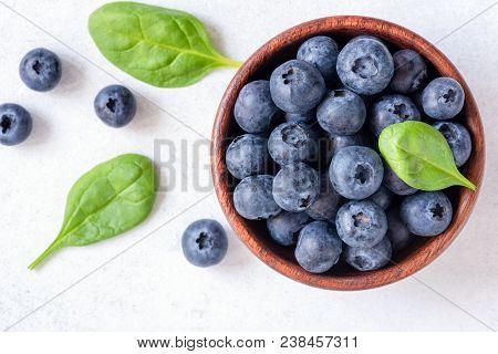 Fresh Blueberries In Bowl On White Background, Top View. Juicy Ripe Blueberries. Blueberries Isolate