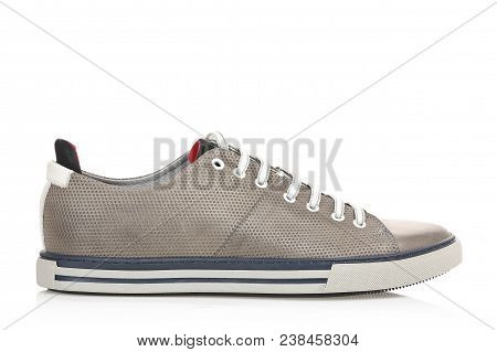 Single Grey Leather Sneaker Isolated On White, Side View