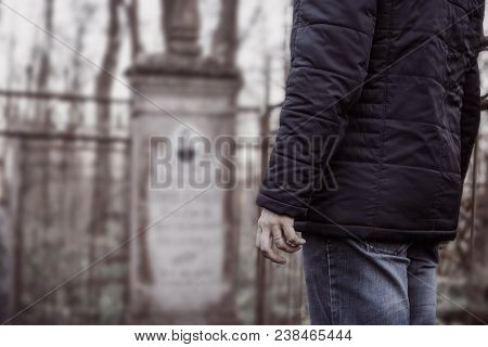 Mourning Man In Cemetery At Grave And Tombstone, Grief And Sadness For Departed Native People Concep