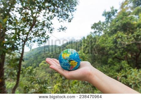 Globe In Hand. The Whole World In Your Hands. Protect The World From War And Disaster.