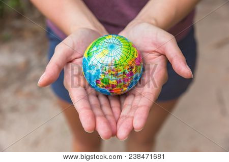 Globe In Hands. The Whole World In Your Hands. Protect The World From War And Disaster.