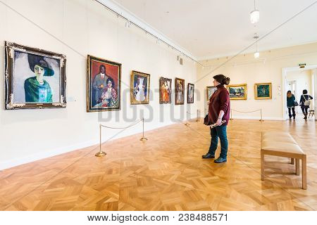 Saint Petersburg, Russia - March 18, 2018: Visitor Views Paintings In New Hermitage Museum In Genera