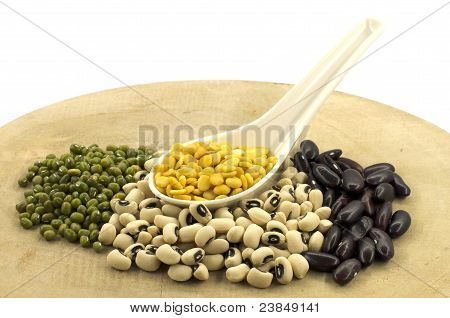 The Various Legumes In Different Colors With White Spoon