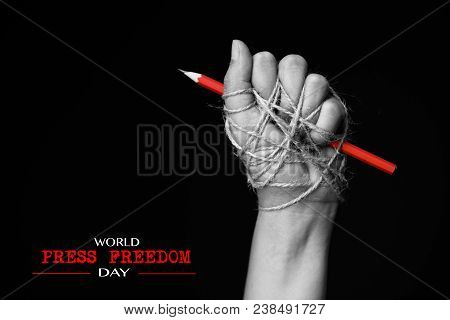 Hand With Red Pencil Tied With Rope, Depicting The Idea Of Freedom Of The Press Or Freedom Of Expres
