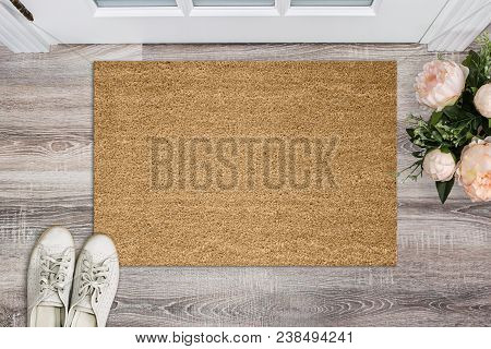 Blank coir doormat before the door in the hall. Mat on wooden floor, flowers and shoes. Welcome home, product Mockup. poster