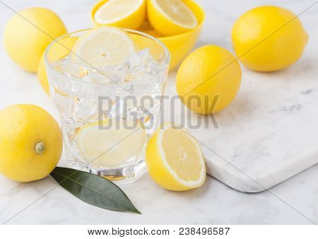Glass Of Organic Fresh Lemon Still Summer Water With Raw Lemons On Marble Background.top View