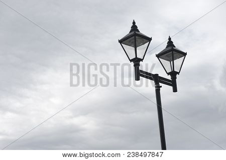 Lamppost With Two Lights Against A Blue Sky With Copy Space