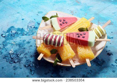 Colorful Popsicle Or Vanilla Frozen Yogurt Or Soft Ice Cream.