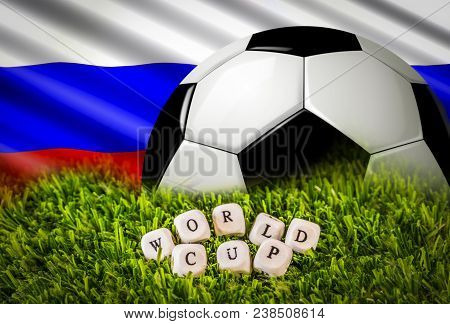 Barcelona, Spain, April 2018: Russian Flag, Football Ball And World Cup Phrase Formed By Wooden Lett