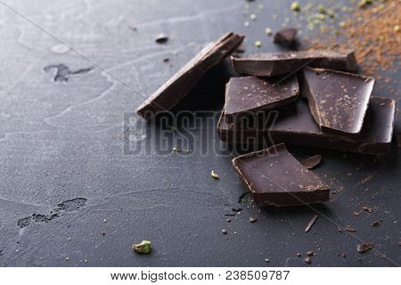 Culinary Sweet Background. Noble Dark Chopped Chocolate Bars And Aromatic Sifted Cocoa Powder On Bla