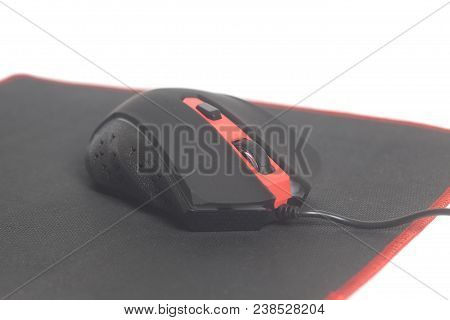 Computer Modern Gaming Mouse On Black Mouse Pad Isolated On White Background