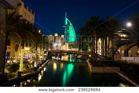 Dubai, United Arab Emirates - April 20, 2018: Burj Al Arab Luxury Hotel Reflected In Water At Night,