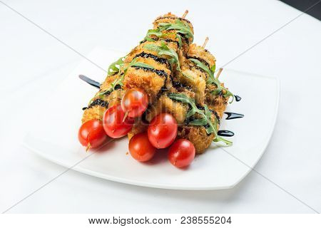 Vegetables On Skewer Fried In Batter Decorated With Tomatoes Zucchini Eggplant, Zucchini. White Plat
