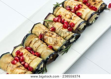 Eggplant With Nuts. Delicious Fried Eggplant Appetizer With Nuts Herbs And Pomegranate Seeds. Georgi