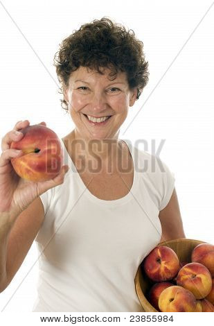 Excited Middle Age Senior Woman With Fresh Peaches Fruit