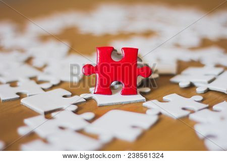 Red Jigsaw Puzzle And White Jigsaw, Teamwork Concept
