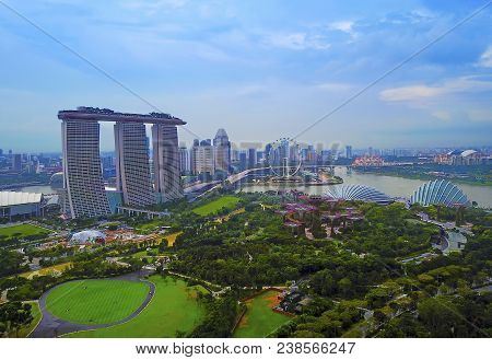 Aerial View Panorama Of Singapore Skyscrapers With City Skyline During Cloudy Summer Day.